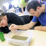 Stefanie Zwygart, of the Ogden Nature Center, and Alan Larsen, of Preston Junior High School, learn about natural gas formations during a workshop that helped educators teach about clean air on Wednesday.